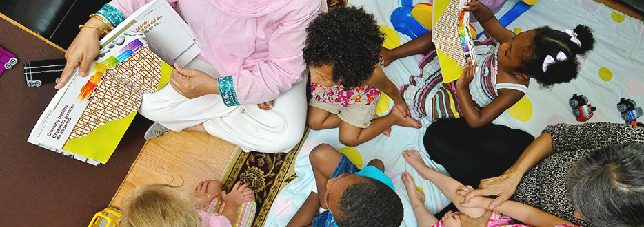 children huddled with provider during storytime